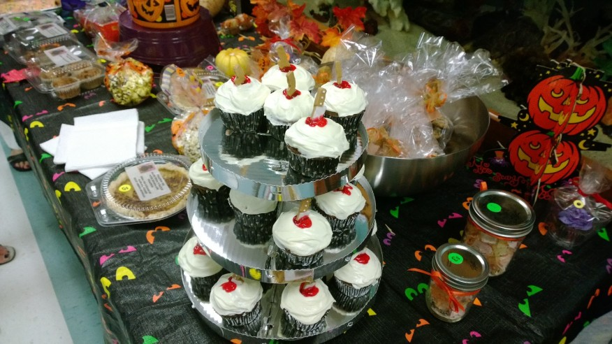 Three tiers of murderous cupcakes offered for sale Oct. 26 help raise funds for the Parent Teach Organization, along with hundreds of baked goods featured in the first-floor main hallway at Anna Maria Elementary School's Fall Festival.