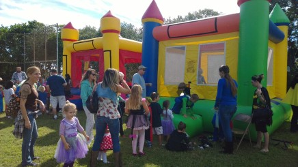 Two bouncehouses in the field behind the school keep kids busy at the Oct. 26 Fall Festival.