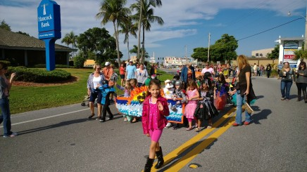 Anna Maria Elementary kindergarteners step off in the lead of the costume parade from the Anna Maria Island Chamber of Commerce, ushered on Gulf Drive by members of the Holmes Beach Police Department to the elementary school.