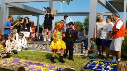 Fourth-graders Kennedy Bullard and Destin Gullamundi collect prizes in the student costume contest that recognizes one boy and one girl from each class.