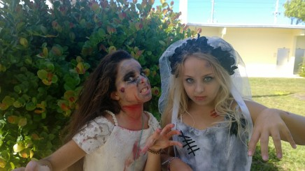"Skylar Hendler and Ella Coney-Jones — zombie brides — exit the haunted house. ""It was awesome!"" Skylar said. ""At the end there's a scary guy with a shovel,"" Ella said."