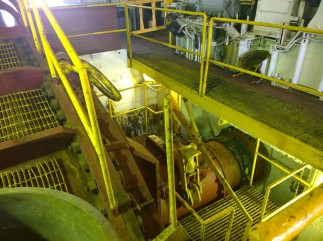 The cutter is driven by a large pump housed inside the dredge barge.