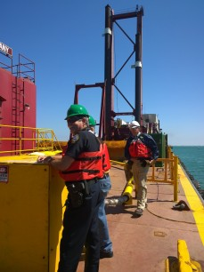 Bradenton Beach Police Chief Sam Speciale stands on the deck of the California during a tour of the dredge barge.