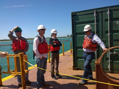 Great Lakes Dredge and Dock Co. project manager speaks to city and county officials on the deck of the California.