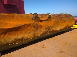 Large metal floats are used to run pipe, and raise and lower pipe into the water.