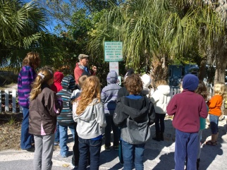Laura Redeker's third-grade class approaches the beach access near Anna Maria Elementary School, where John Ginaven explains the importance of sea oats.