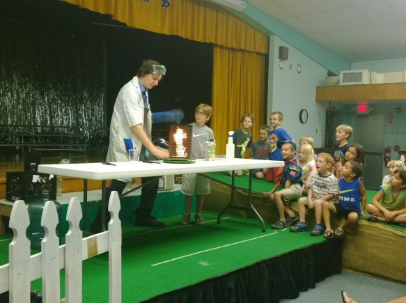 Dr. Frost demonstrates a fire tornado with the assistance of fourth-grader Cole Pearson during the MOSI STEAM punks fire and ice show.