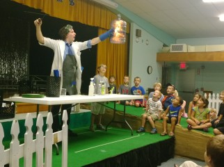"Fourth-grader Cole Pearson assists Dr. Frost of the MOSI STEAM punks during a demonstration on fire and fuel. Cole filled a large bottle with ""fuel"" and Dr. Frost lit it on fire, creating an explosion inside the tube."