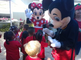 Micky and Mini Mouse attended at the Christmas party, greeting and high-fiving kids. Dora the Explorer, Woody and Sponge Bob also made appearances.