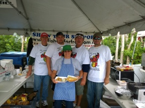 Tim Johnson, Lee Coarsey, Alice Lovett, Marty Lee and Travis Johnson, members of Fishing for Freedom's Manatee chapter, an organization representing commercial fishers, Nov. 9 sell Cortez hot dogs, which are smoked mullet in a hot dog bun, at the Stone Crab Festival.
