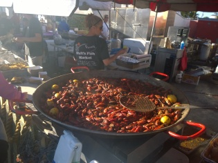 Crayfish cooks in a large pan, alongside generous helping of other seafood inspired dishes in the historic fishing village during the Cortez Commercial Fishing Festival Feb. 15.