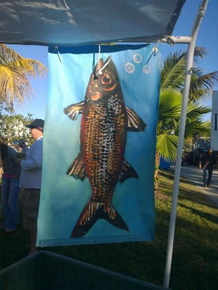 Flags resembling guyotaku prints hung around the edges of the Cortez Fishing Festival Feb. 15.